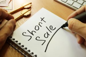 Short sale underlined in notebook